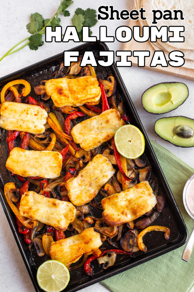 Roasted vegetables and halloumi on a baking tray.