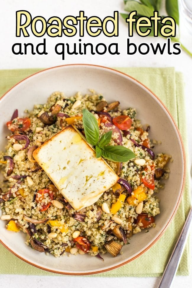 Vegetable quinoa in a bowl topped with a piece of roasted feta cheese, shot from above