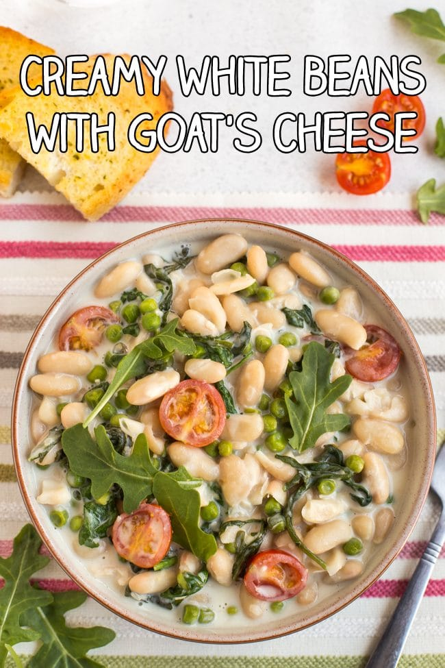 Creamy white beans with rocket and tomatoes in a bowl