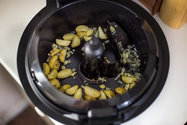 Potatoes and onion cooking in Tefal ActiFry