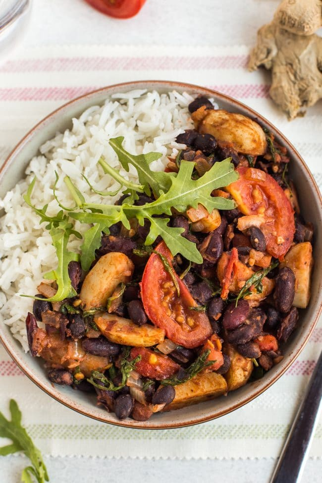 Madagascan bean stew with rice in a bowl, shot from above
