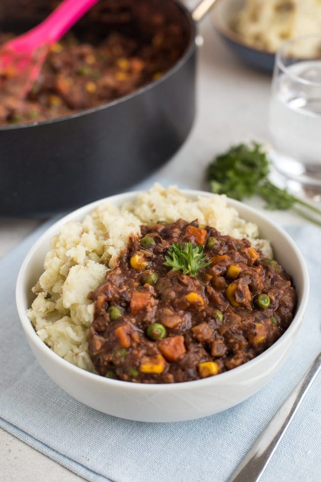 Portion of homemade vegetarian savoury mince in a bowl with mashed potato