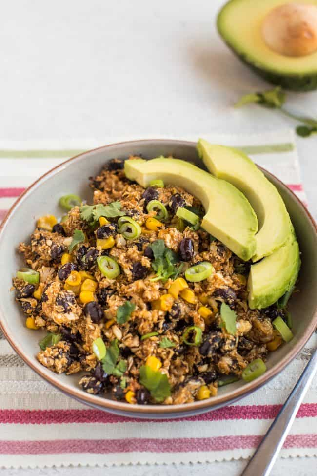 Tex-Mex cauliflower rice in a bowl with avocado