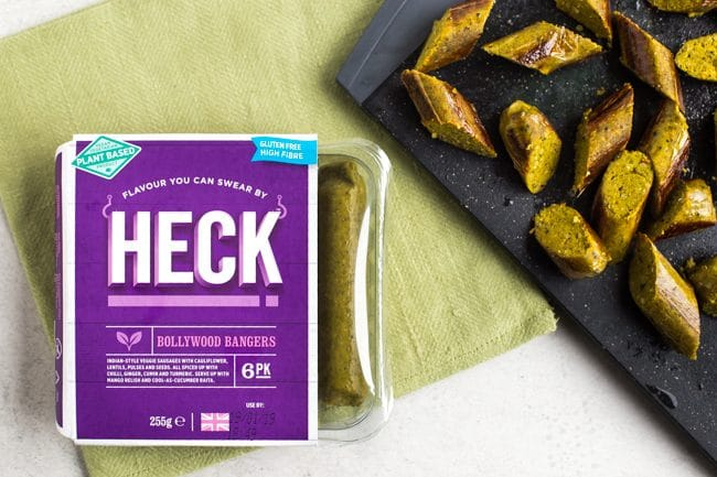 Heck Bollywood Bangers vegan sausages chopped on a cutting board