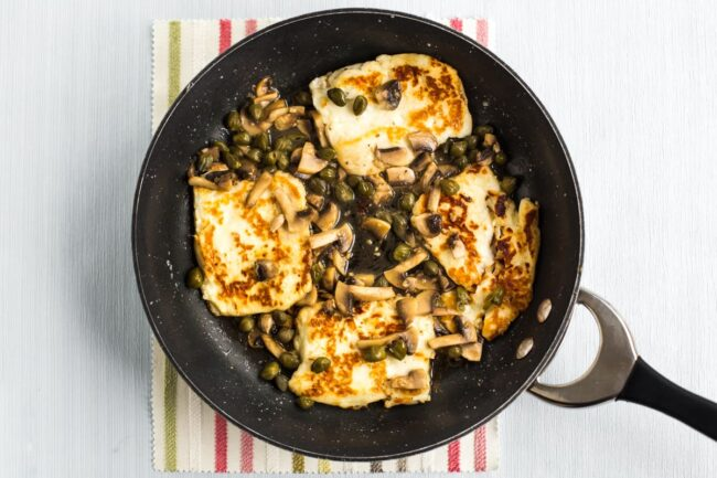 Halloumi piccata cooking in a frying pan