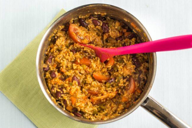 Vegan jambalaya cooking in a saucepan
