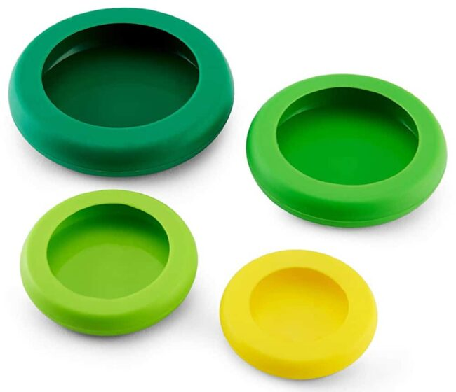 A set of green and yellow food huggers on a white background.