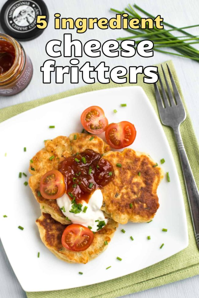 Portion of cheese fritters topped with sour cream and tomato chutney.