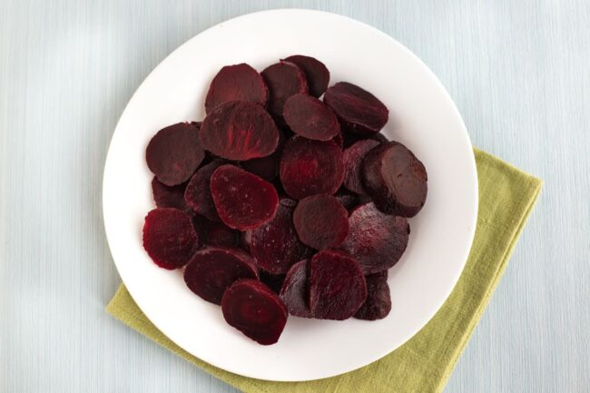 A plate of sliced beetroot.