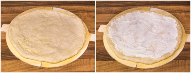 An uncooked pizza base spread with ricotta cheese.