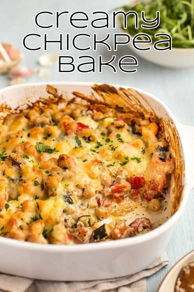Creamy chickpea bake in a dish, with a scoop removed.