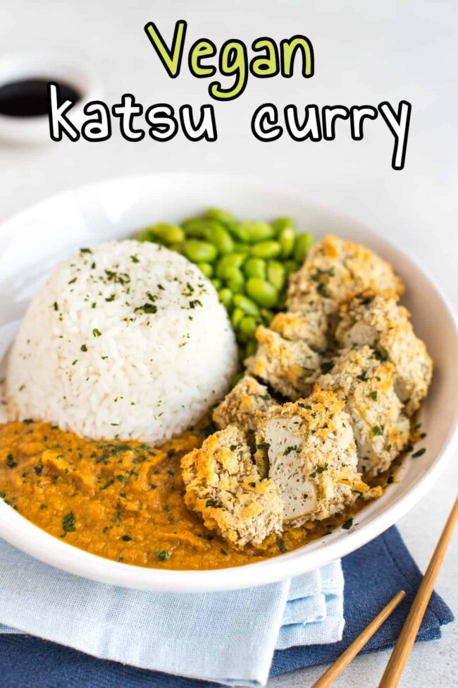 Vegan katsu curry with crispy breaded tofu and rice.