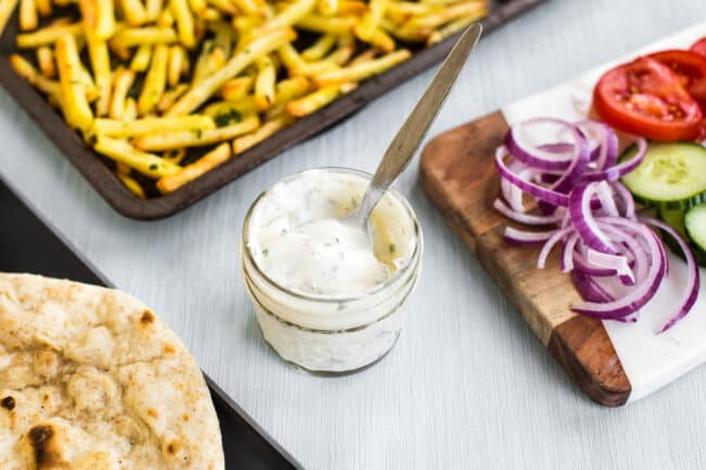 Homemade garlic mayonnaise in a small glass jar.