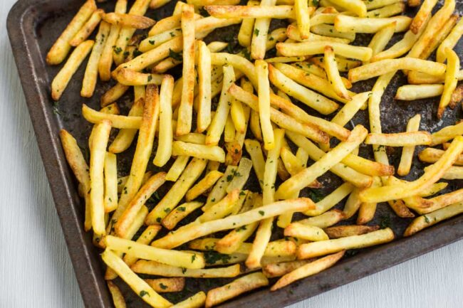 Oven chips on a baking tray.