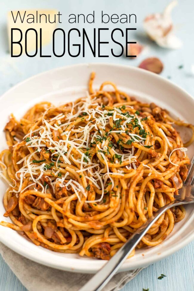 Portion of vegan bean bolognese mixed through spaghetti.