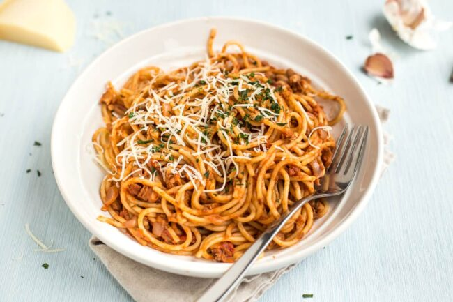 Walnut and bean bolognese sauce on spaghetti.
