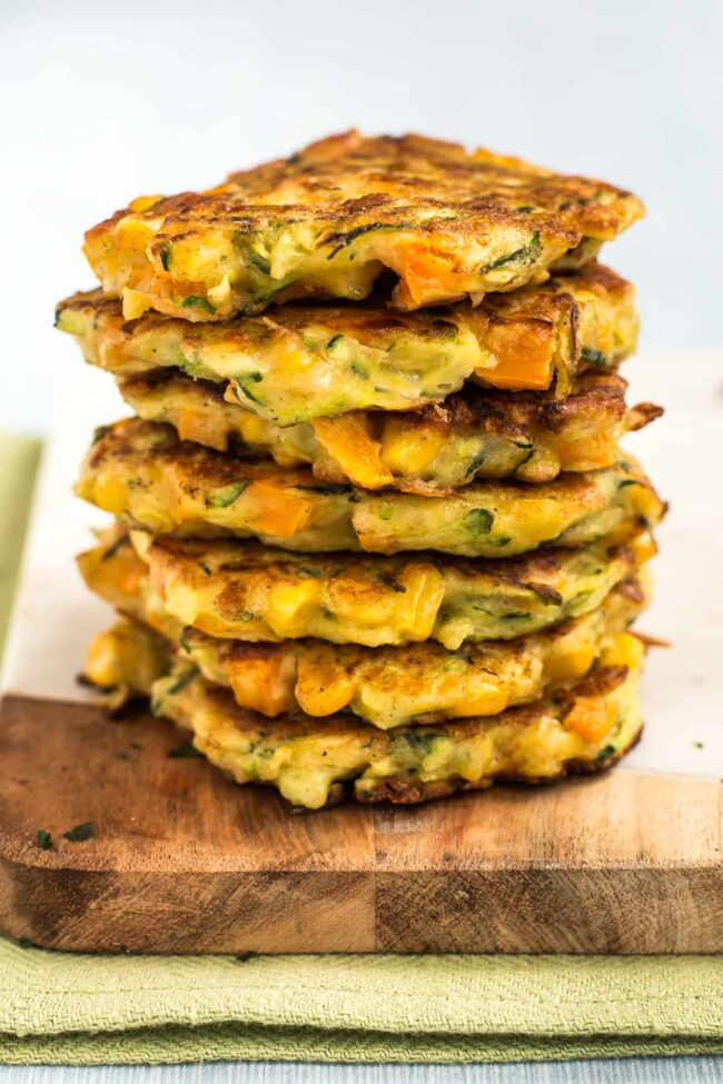 A big pile of cheesy vegetable fritters.