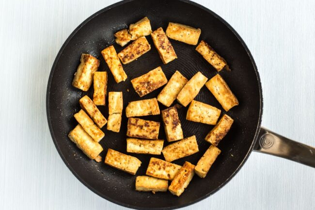 Very crispy tofu cooked in a frying pan.