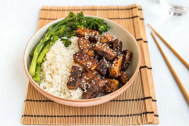 Sticky teriyaki tofu served with broccoli and rice.
