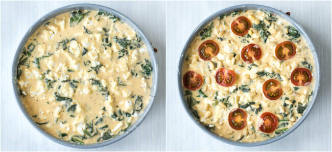 Uncooked spinach quiche topped with cherry tomatoes.