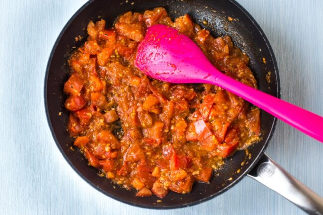 Fresh tomato sauce cooking in a frying pan.