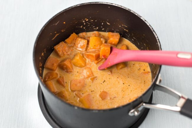 Sweet potato and coconut milk in a pan.