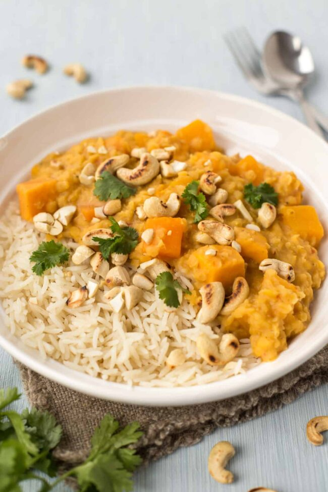 Sweet potato and lentil curry with cashew nuts and cilantro.