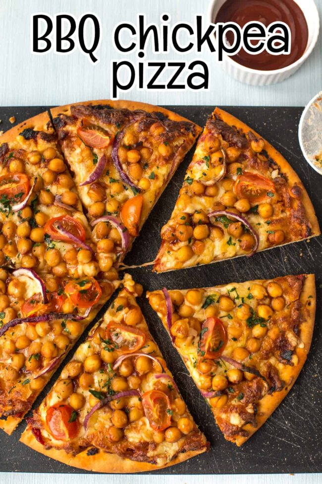 A BBQ chickpea pizza cut into slices, shot from above.