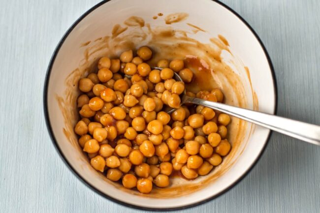 Chickpeas and BBQ sauce mixed in a bowl.