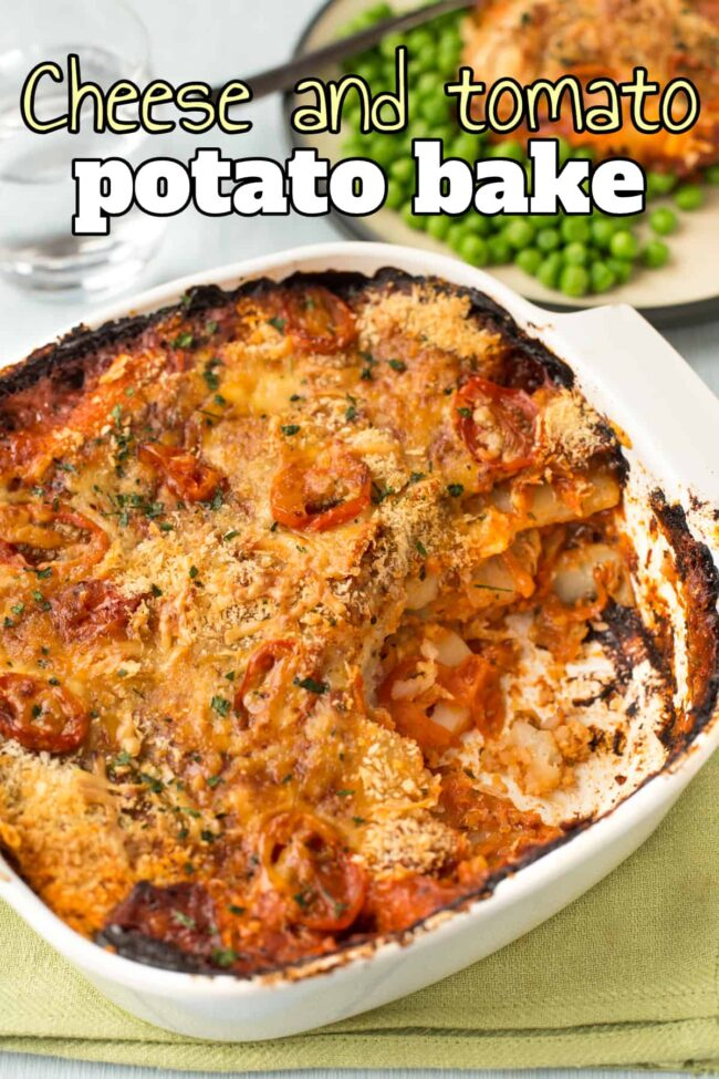 A cheese and tomato potato bake in a baking dish with a scoop removed.