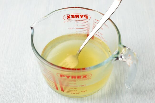 Vegetable stock in a Pyrex jug.