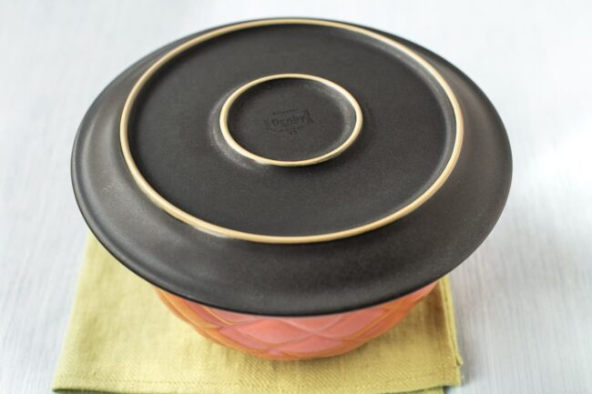 A bowl covered with a plate.