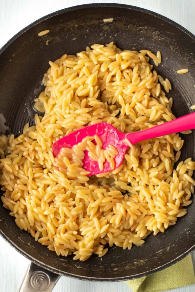 Creamy orzo risotto in a pan.