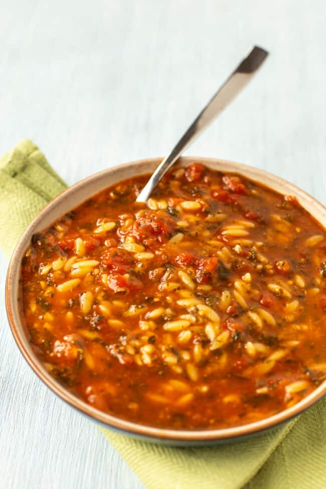 A bowl of tomato soup with orzo.