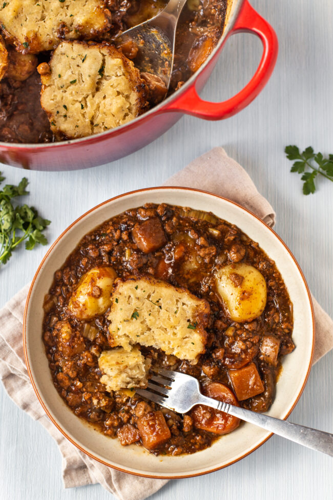 A bowl of vegetarian beef stew topped with a suet dumpling.