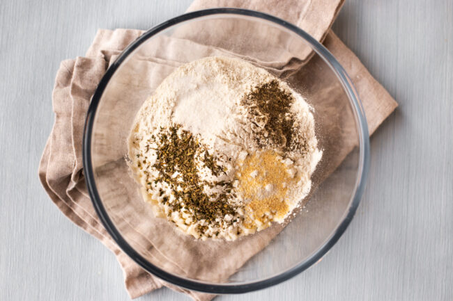 Seasonings and herbs with flour in a bowl.
